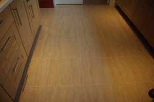 """PROJECT FLOORS. 18"""" x 18"""" tiles fitted in a kitchen and utility with 5 mil grout strips"""
